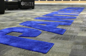 custom locker room flooring, athletic locker room flooring, college sports locker room, athletic locker room flooring, football locker room flooring, university locker room flooring, luxury athletic flooring, luxury collegiate locker room, nice locker room flooring, fancy locker room flooring